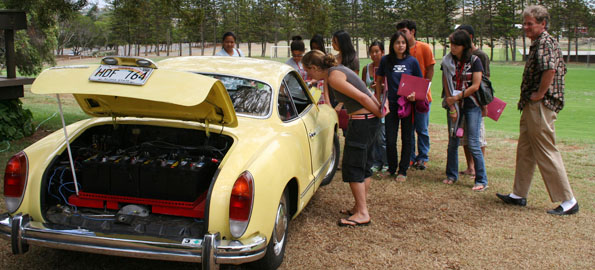 Waimea resident Doug Teeple (right), who has not been to a gas station in more than two years, shares his e-Ghia with students.