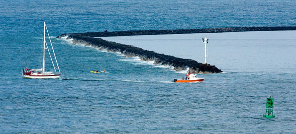 A Fire Department rescue boat tows a disabled vessel into Hilo Bay Tuesday afternoon, July 7.