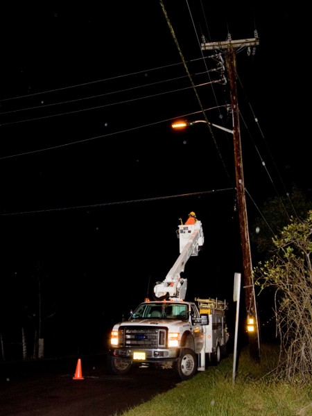 A HELCO crew shuts down power to lines running on Ihope Road due to an accident damaging a utility pole.