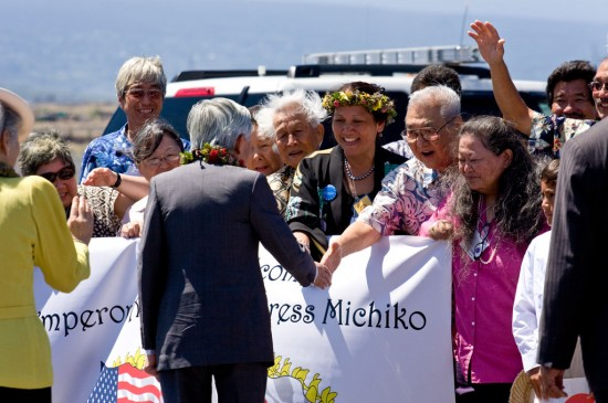 Emperor Akihito and Empress Michiko shake hands with Big Islanders at the airport.