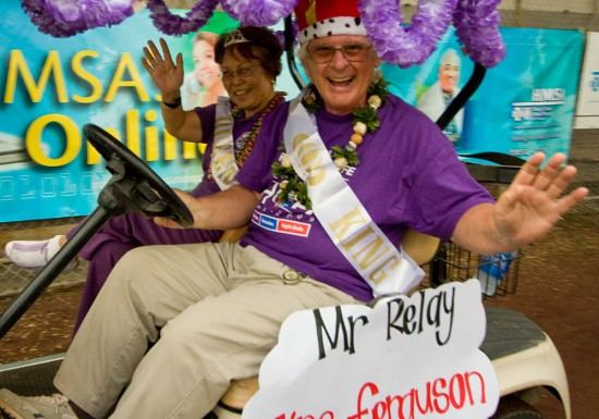 Mr. and Mrs. Relay for Life Jim Ferguson and Jean Okuma ride at the start of the first lap with cancer survivors and caregivers.