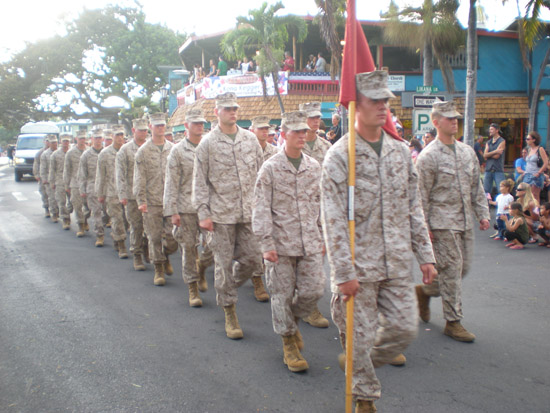 The formation of Marines drew a standing ovation along the parade route.