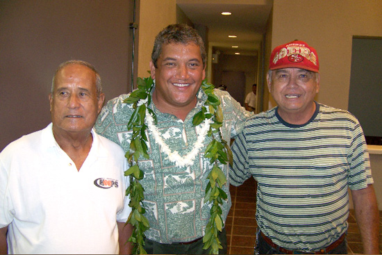 Mayor Billy Kenoi along with former Kohala High School basketball coach Joe Mattos, and veteran's advocate Richard Caravalho in the lobby off the reopened Hisaoka Gym. (Hawaii247 photo courtesy of Bobby Command)