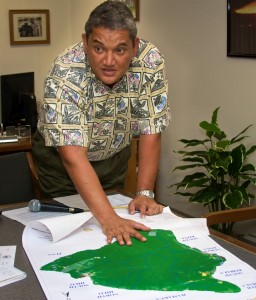 Mayor Billy Kenoi goes over a map showing the different zoned areas of land on the Big Island that is taxed for residential, agricultural, resort, industrial, etc. Photography by Baron Sekiya | Hawaii 24/7