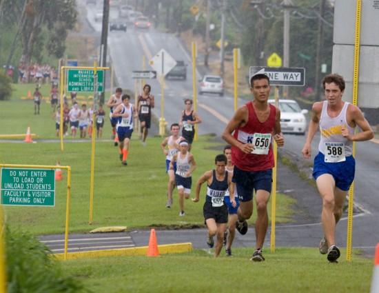 Runners head up Puainako Street during the BIIF cross country meet at Waiakea High School.
