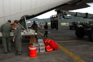 PAGO, PAGO, American Samoa - A Honolulu-based U.S. Coast Guard C-130 long-range search plane from Air Station Barbers Point arrives in Pago Pago, Wednesday, Sept. 30, 2009, to deliver aid and assess damage after a powerful earthquake and tsunami hit the U.S. territory. (U.S. Coast Guard photo/Petty Officer 3rd Class Luke Clayton)