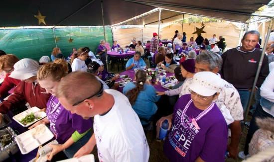Cancer survivors and caregivers enjoy a dinner at Waimea Park before the Relay for Life.