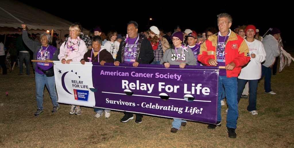 Cancer survivors and caregivers take the first lap at the Relay for Life event at Waimea Park Saturday night (Oct 17). Participants are doing laps around the field for 24 hours. Participants along with a silent auction and sale of food are raising funds for the American Cancer Society.