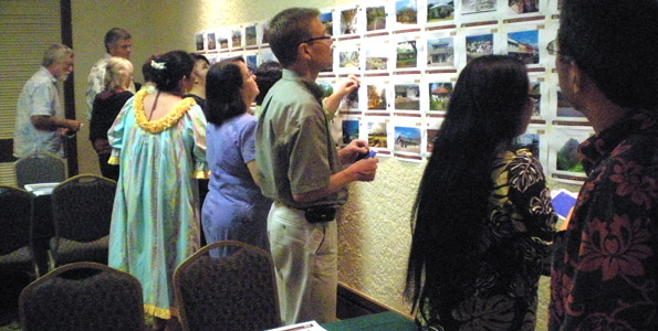 Charrette participants vote on how they would like Honokohau Village to look. (Hawaii247 photo by Karin Stanton)