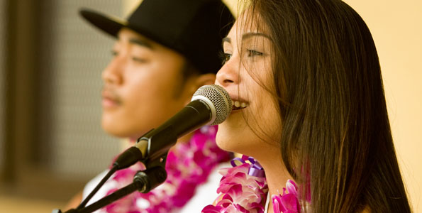 Divina Medeiros and Paul Battad perform a Bob Marley song. Food, fun, games and local entertainment were featured Saturday (Nov 21). Money raised to benefit the school's clubs and teams.