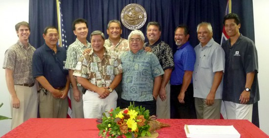 Part of the team that helped facilitate the Ane Keohokalole Highway. From left, Race Randle of Forest City; Public Works Director Warren Lee; Executive Assistant Bobby Command; Deputy Managing Director Wally Lau; Mayor Billy Kenoi; Office of Hawaiian Affairs Trustee Bob Lindsey; state Transportation Director Brennon Morioka; Hawaiian Homelands manager for Hawaii Island James DuPont; Laiopua 2020 Executive Director Bo Kahui; Hawaiian Homelands Chairman Kaulana Park. (Photo courtesy of the Mayor's Office)