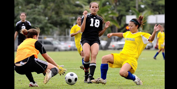 In BIIF girls soccer action the visiting St. Joseph Lady Cardinals ran into an overpowering Hilo High Viking team.
