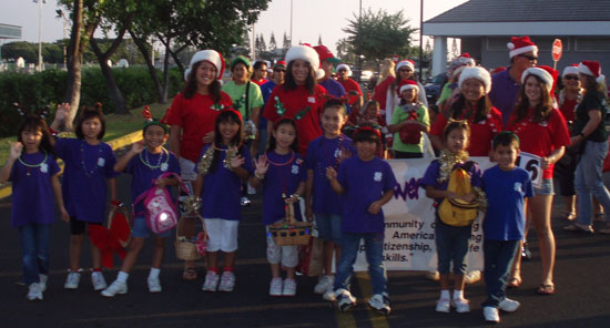 The Busy Bee Buddies and the Kona 4-H Federation marched in the annual Christmas Parade. (Hawaii 24/7 photo courtesy of Margaret Masunaga)