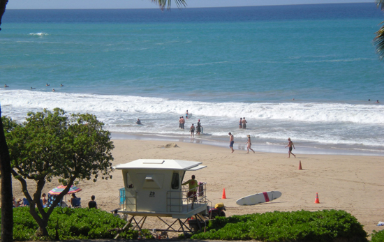 A lifeguard stands watch Tuesday morning at Hapuna Beach State Recreation Area. (Hawaii 24/7 photo by Karin Stanton)