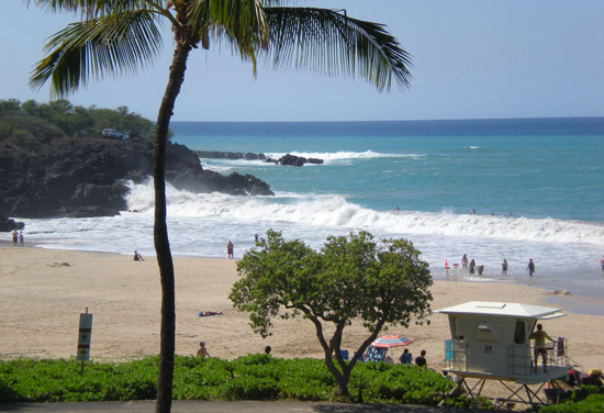 A little bit of surf didn't stop beachgoers from enjoying Hapuna Beach State Recreation Area. (Hawaii 24/7 photo by Karin Stanton)