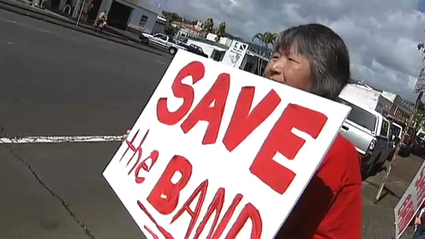 Supporters rallied around the Hawaii County Band Saturday (March 13) in Hilo as budget cuts threaten the existence of the 127 year-old tradition. The band played a concert at the Mooheau Park Bandstand.