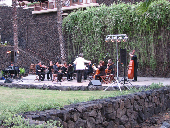 """All students will be admitted free to """"Pacific Moon Under the Stars,"""" the next concert by the Orchestra of the Hawaiian Islands, Saturday, August 7, 6 pm, at the Hilton Waikoloa Village Kamehameha Court.  Conductors Philip Simmons and Hiroaki Ueba will lead members of the Honolulu Symphony Orchestra in a world music program with works by Queen Lili'uokalani, Yasushi Akutagawa, Edvard Grieg, Antonio Vivaldi, and popular selections by American composers George Gershwin, Leroy Anderson, John Williams, and Harold Arlen."""