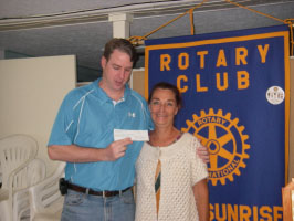 The Rotary Club of Kona Sunrise is pleased to announce that it has awarded a scholarship to a local student to attend the 2010 Hawaii Island Hoops College Prep Basketball Camp. Monies were raised from club members and a check was presented last week to Andy Smith, Director of Hawaii Island Hoops.