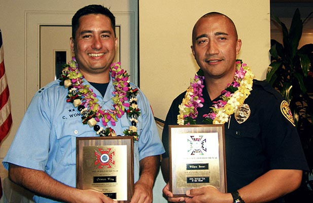 "The Aloha Exchange Club of East Hawai'i recognized Officer William ""Willie"" Brown as ""Officer of the Year"" and Captain Christian Wong as ""Fire Fighter of the Year"" in a dinner ceremony Thursday evening (March 18)."