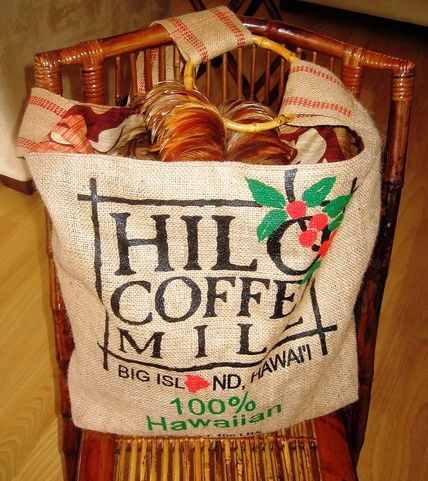Thanks to Manila Extract, a local artist, the burlap bags with the Hilo Coffee Mill logo, can now carry a dancer's precious hula implements. Fully lined, in an assortment of aloha prints, the Hula Bag includes a magnetic snap, interior pocket and strong carry strap. Just in time for the Merrie    Monarch festival, The Hilo Coffee Mill Hula Bag by Manila Extract   www.ManilaExtract.etsy.com) is available exclusively at Hana Hou in Hilo at 164 Kamehameha Avenue.