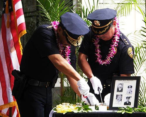 """Members of the public helped the Hawai'i Police Department celebrate Police Week on Monday (May 10) at the Hilo police station.    In an outdoor ceremony, Mayor Billy Kenoi read a proclamation declaring May 9-15 as Police Week. He commended Chief Harry Kubojiri and the police officers who serve under him. """"Not a day goes by that I'm not proud to serve with all of them,"""" Kenoi said."""