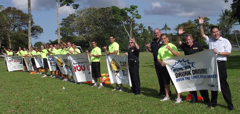 The Hawai'i Police Department's Traffic Services Section organized a sign-waving event on Kamehameha Avenue in Hilo on Monday (June 28). This event was to remind motorists that Independence Day weekend is just around the corner and to make everyone aware of the danger of drinking and driving.