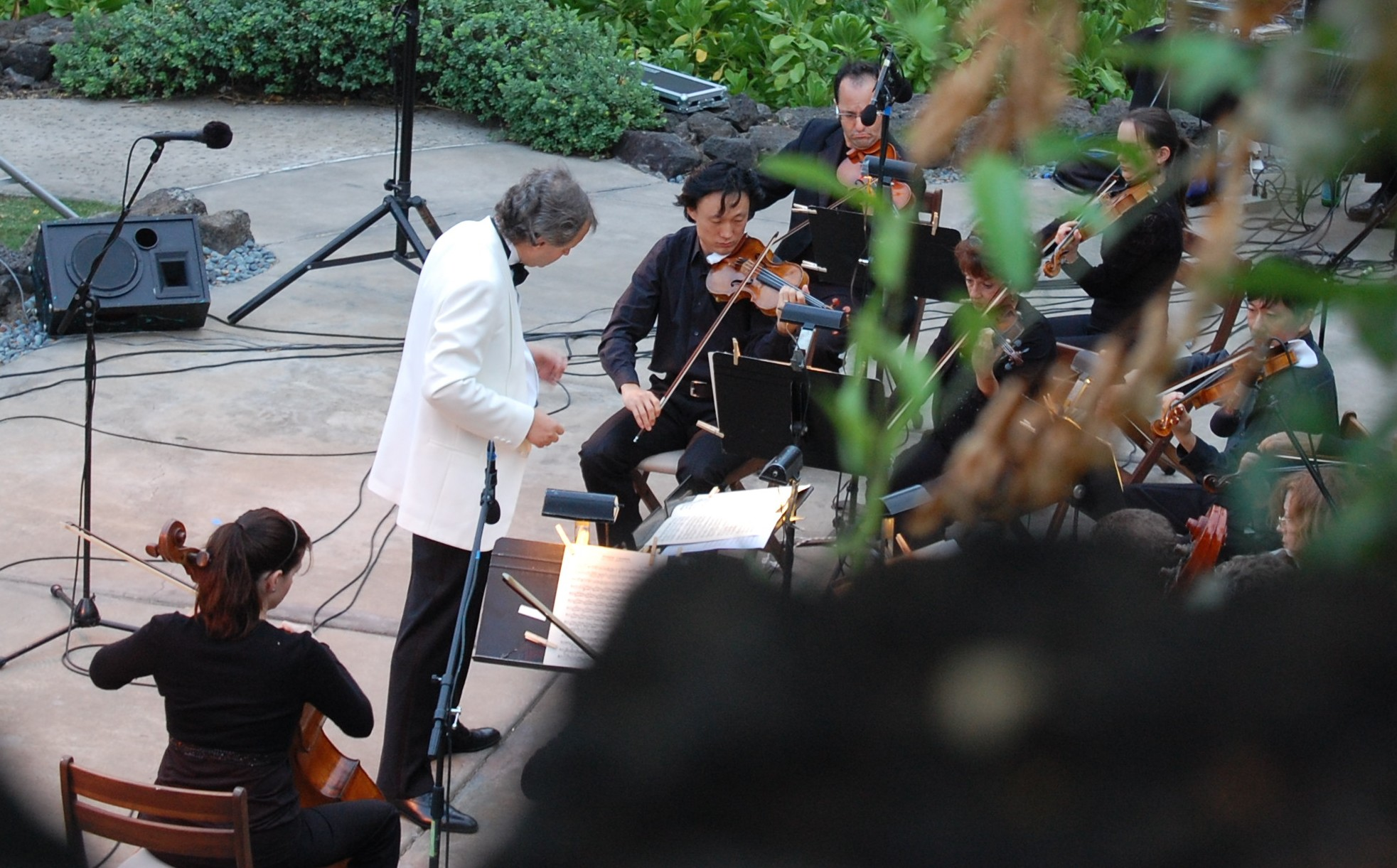 """The Orchestra of the Hawaiian Islands performs """"Pacific Moon Under the Stars,"""" Saturday, August 7, 6 PM, at the Hilton Waikoloa Village Kamehameha Court. The concert will include Hawaiian and Japanese music, along with works by Gershwin, Grieg, and Vivaldi. Guest conductor will be Hiroaki Ueba (Japan) with American Music Festivals Artistic Director Philip Simmons as guitar soloist."""