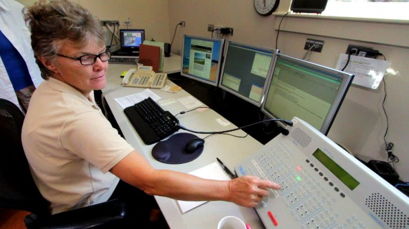 Hawaii Volcanoes National Park Dispatcher Annette Thornberry demonstrates the communications system used between the National Parks on the Big Island and in the Pacific like Guam.