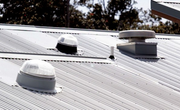 Clear domes pipe sunlight for illumation into the The maile lei is untied for the opening of the Hawaii Volcanoes National Park Visitor Emergency Operations Center to save energy. The building also has an air filtration system to deal with dangerous levels of volcanic fumes.