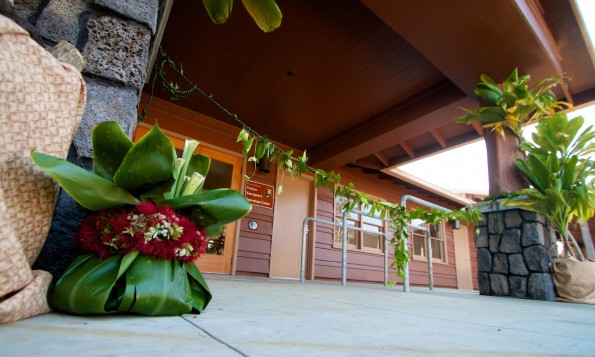 A ho'okupu (gift) wrapped in ti leaf and a maile lei across the entrance of the Hawaii Volcanoes National Park Visitor Emergency Operations Center.