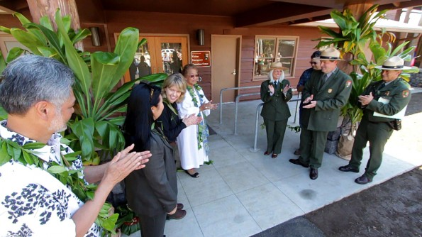 The maile lei is untied for the opening of the Hawaii Volcanoes National Park Visitor Emergency Operations Center.