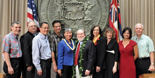 Governor Neil Abercrombie (center) with new appointees to the Board of Education. Board of Education Chairman Don Horner, Hawaii County representative Brian DeLima, Keith Amemiya, Maui County representative Wesley Lo, Charlene Cuaresma, Cheryl Kauhane Lupenui, Kauai County Representative Nancy Budd, Kim Gennaula and Jim Williams. Photo courtesy of the Office of the Governor.