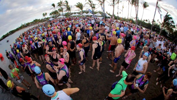 Swimmers get last minute instructions before the start of the 14th Annual Lavaman Triathlon at Anaehoomalu Bay in Waikoloa. Photography by Baron Sekiya | Hawaii 24/7