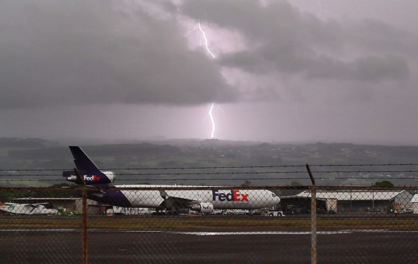 Lightning strikes Hilo as seen from Hilo International Airport Monday afternoon (May 2). Photography by Baron Sekiya | Hawaii 24/7