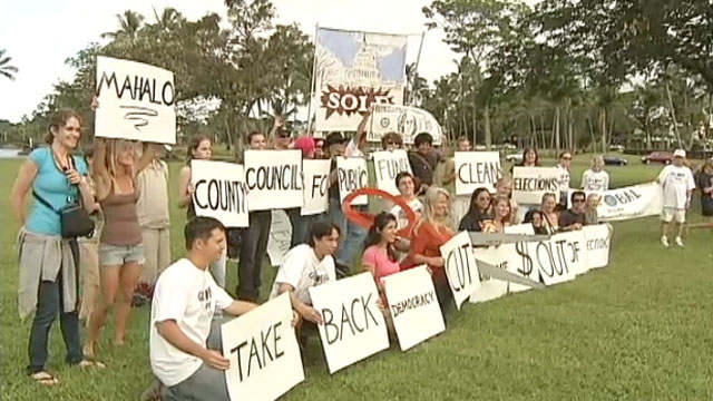 Students and supporters of Hawaii County's new Fair Election law rallied in Hilo Tuesday.