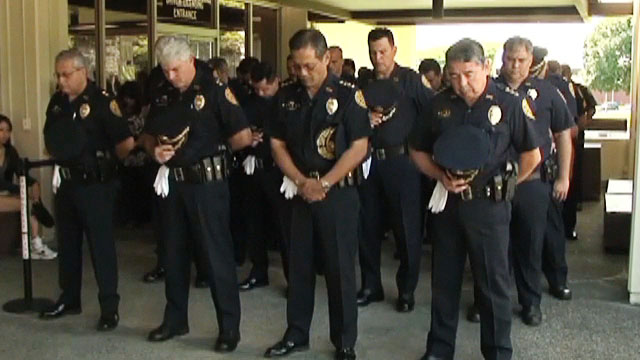 """Members of the public helped the Hawai'i Police Department celebrate Police Week on Monday (May 16) at the Hilo police station.  The outdoor ceremony honored four Big Island police officers killed in the line of duty: Manuel Cadinha (1918), William """"Red"""" Oili (1936), Ronald """"Shige"""" Jitchaku (1990), and Kenneth Keliipio (1997)."""