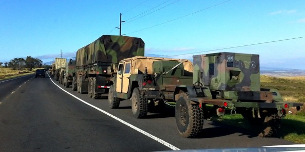 A military convoy pulls over onto the shoulder of Mamalahoa Highway (Hwy 190) to let traffic pass after exiting Saddle Road as it heads south to Waikolola Road. You probably would not want to get stuck behind this convoy on Saddle Road. Photography by Baron Sekiya | Hawaii 24/7