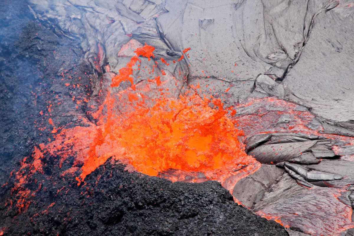 Lava is erupting continuously within Pu`u `O`o over the past week, feeding a lava lake perched above the crater floor.