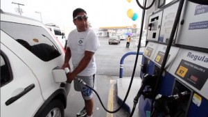 An officer fills a gas tank at Bayfront Tesoro during the 2011 Fueling Dreams.