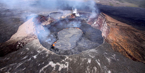 Aerial view looking southwest into Pu'u 'O'o crater with its lava lake perched five to eight meters above the surrounding lava flows.
