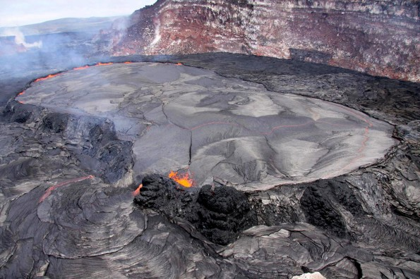 A breach in the south wall of the perched pond allowed lava to gush out onto the floor of Pu'u 'O'o Crater. Photo courtesy of USGS/HVO