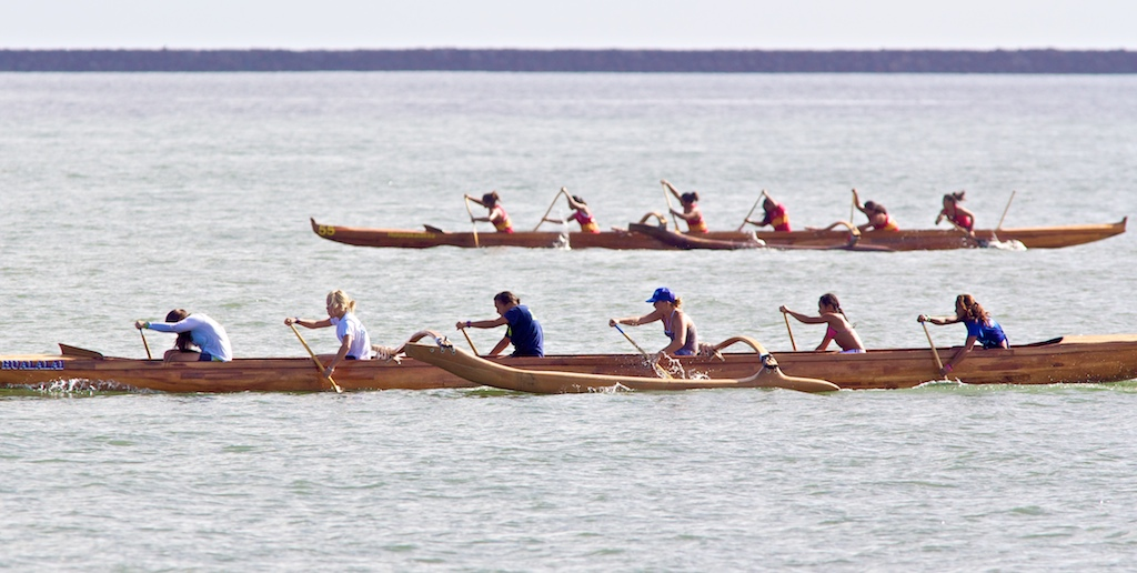 The Kai Opua crew heads for the finish line in the Girls 12 quarter-mile race in Hilo Bay to open the day of racing at the Kamehameha Canoe Club regatta Saturday (July 9). Full results.