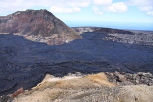 Looking south toward the MLK pit (straight) and Puka Nui pit (right). Lava is only a few meters (yards) away from overtopping the pits and flowing onto the southwest flank of Pu'u 'Ō 'ō. Photo courtesy of USGS/HVO