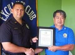 Aloha Exchange President Dale Tokuuke presents an 'Officer of the Month' award to Officer Erhard Autrata
