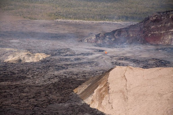 A lava lake also fills the western side of the crater. This morning, lava overflowed that lake, and then filled and overtopped the northwest rim of a pit on the west side of the crater (the West Gap pit; just above and to the right side of the photo). These flows have traveled up to about 400 m down the northwest flank of Pu'u 'O'o to its base. View is to the northwest.