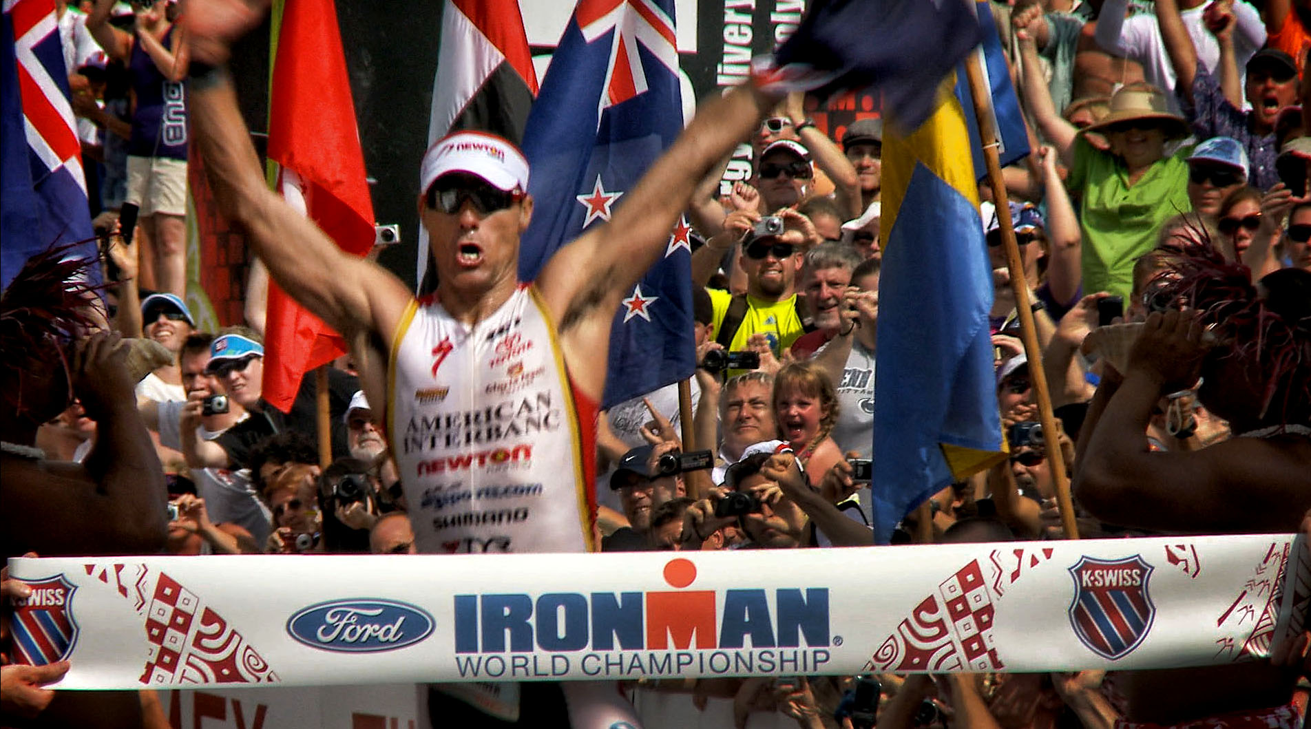 Craig Alexander wins the Ironman World Championship and sets a new course record in 8 hours, 03 minutes, 56 seconds. The previous course record was 8:04:08 was set in 1996 by Belguim's Luc Van Lierde.