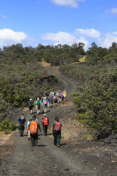 Visitors walk through the Kahuku Unit of Hawaii Volcanoes National Parl. Photo courtesy of NPS/Dave Boyle