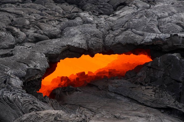 This skylight provided a clear view of the lava stream inside the lava tube on today'€™s overflight, and a swiftly moving current could easily be seen. Photo courtesy of USGS/HVO