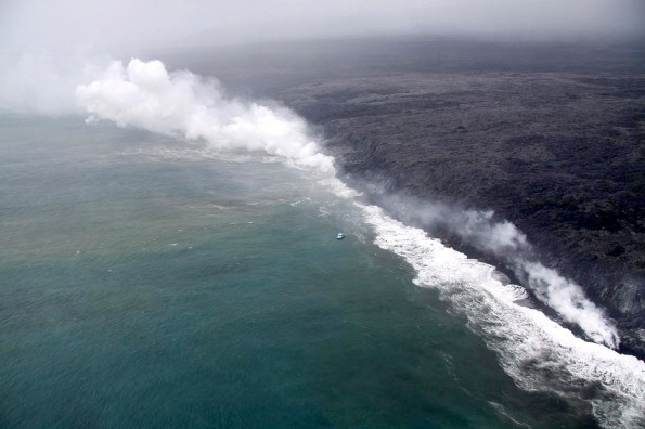 Lava has continued to enter the ocean at West Kailiili, with numerous entry points scattered along a broad section of the coast. The small boat in the center of the image provides a rough sense of scale. Photo courtesy of USGS/HVO