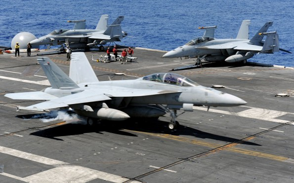 An F/A-18F Super Hornet assigned to the Blue Blasters of Strike Fighter Squadron  2 lands on the flight deck of the aircraft carrier USS Abraham Lincoln 72. VFA-2 is part of the Abraham Lincoln Carrier Strike Group, which is on a scheduled deployment to the U.S. 7th and 5th Fleet areas of responsibility, supporting maritime security operations and theater security cooperation efforts to establish conditions for regional stability. U.S. Navy Photo by MC2 Alan Gragg